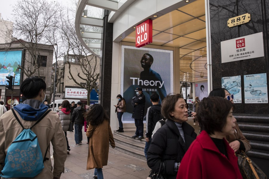 Pedestrians walk past a Uniqlo store in Shanghai, China, on 26 March 2021. Japanese brands Muji and Uniqlo became the latest to be embroiled in the escalating controversy over cotton sourced from China's Xinjiang region. (Qilai Shen/Bloomberg)