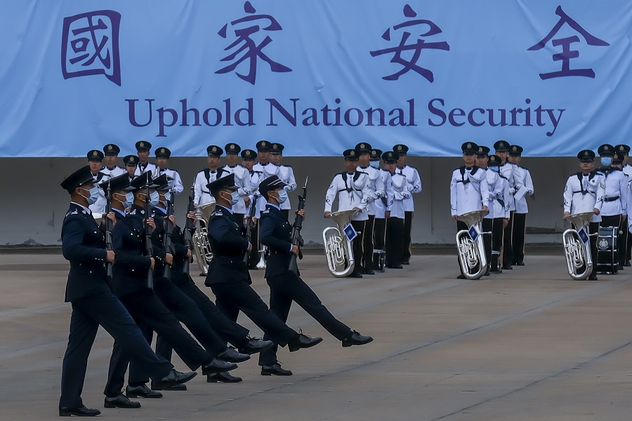 Police officers perform a drill during an open day for National Security Education Day at the Hong Kong Police College in Hong Kong, China, on 15 April 2021. (Paul Yeung/Bloomberg)