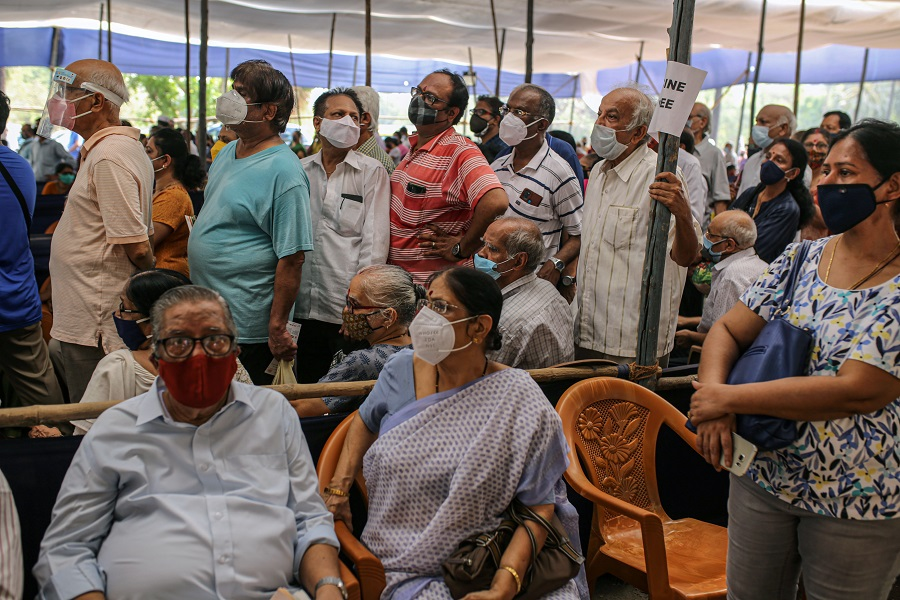 People in a waiting area at a Covid-19 vaccination centre at the Goregaon NESCO jumbo Covid centre in the Goregaon suburb of Mumbai, India, on 27 April 27. (Dhiraj Singh/Bloomberg)
