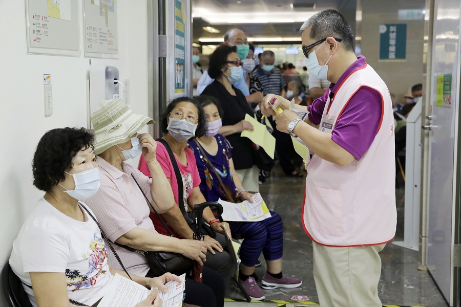 People wait in line at a Covid-19 vaccination centre set up at Far Eastern Memorial Hospital in New Taipei City, Taiwan, on 13 May 2021. (I-Hwa Cheng/Bloomberg)