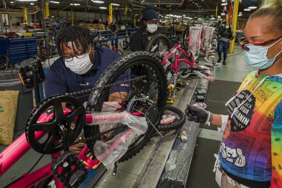 Bicycle Corporation Of America employees work on the assembly line at a Kent Bicycles production facility in Manning, South Carolina, U.S., on 13 May 2021. (Micah Green/Bloomberg)