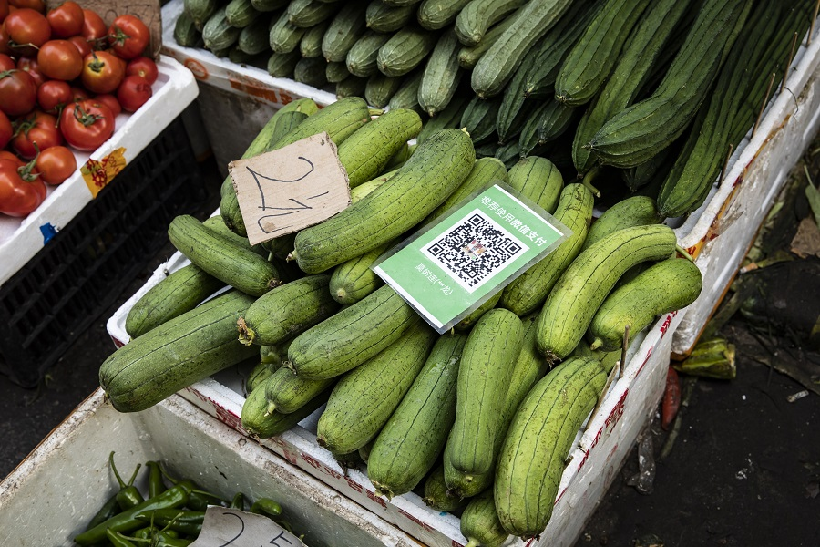 A box of gourds with a QR code for digital payment at an open-air market in Guangzhou, China, on 24 May 2021. (Qilai Shen/Bloomberg)