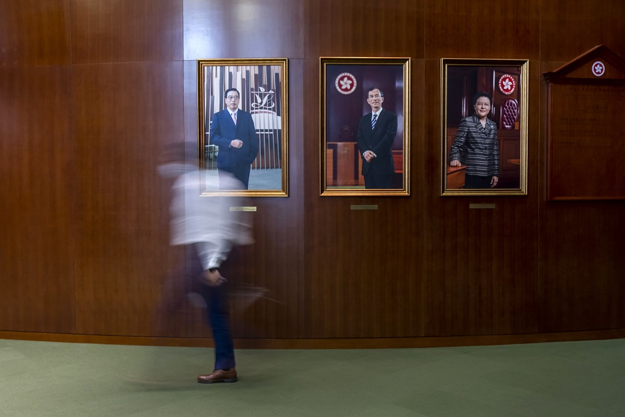 A person walks past portraits of current and former Legislative Council Presidents Andrew Leung (left), Jasper Tsang (centre), and Rita Fan at the Legislative Council in Hong Kong, China, on Wednesday, 26 May 2021. (Paul Yeung/Bloomberg)