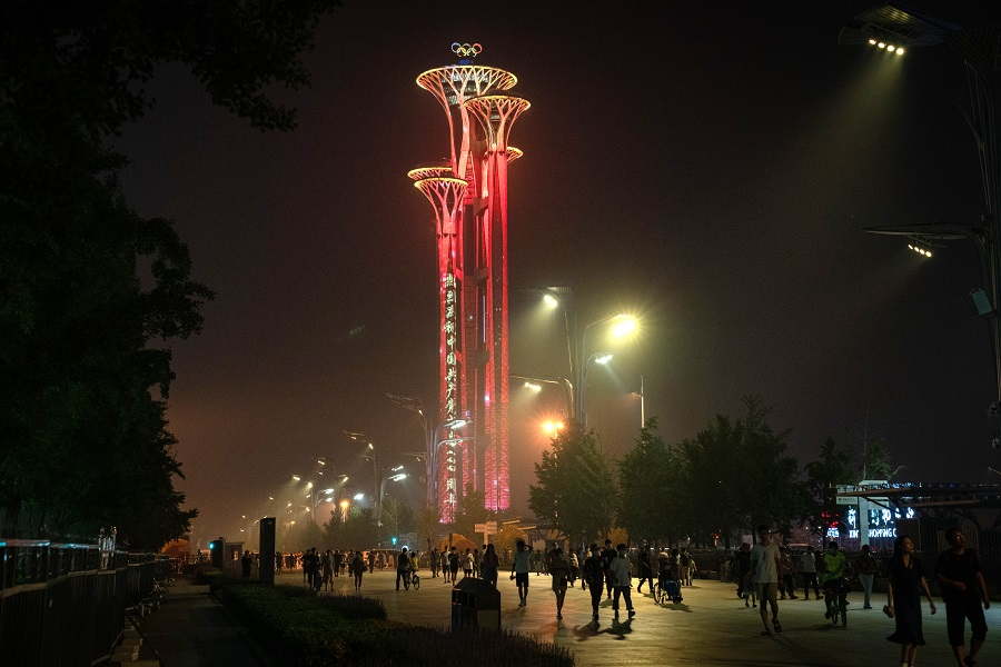 A message celebrating the centenary of the Chinese Community Party illuminates the Beijing Olympic Tower in Beijing, China, on 26 June 2021. (Yan Cong/Bloomberg)
