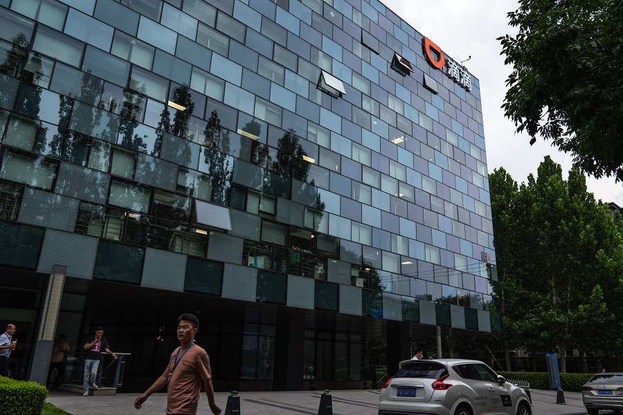 A pedestrian passes Didi Global Inc. headquarters in Beijing, China, on 5 July 2021. (Yan Cong/Bloomberg)