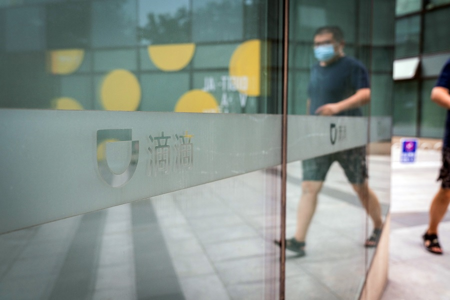 A pedestrian passes a logo at the Didi Global Inc. headquarters in Beijing, China, on 5 July 2021. (Yan Cong/Bloomberg)