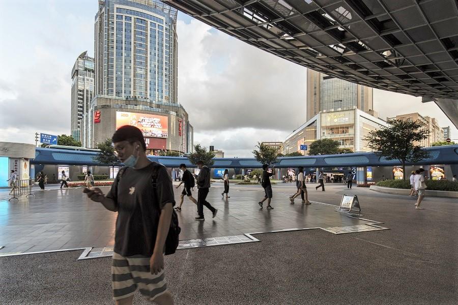 Pedestrians walk through a plaza in Shanghai, China, on 20 July 2021. (Qilai Shen/Bloomberg)