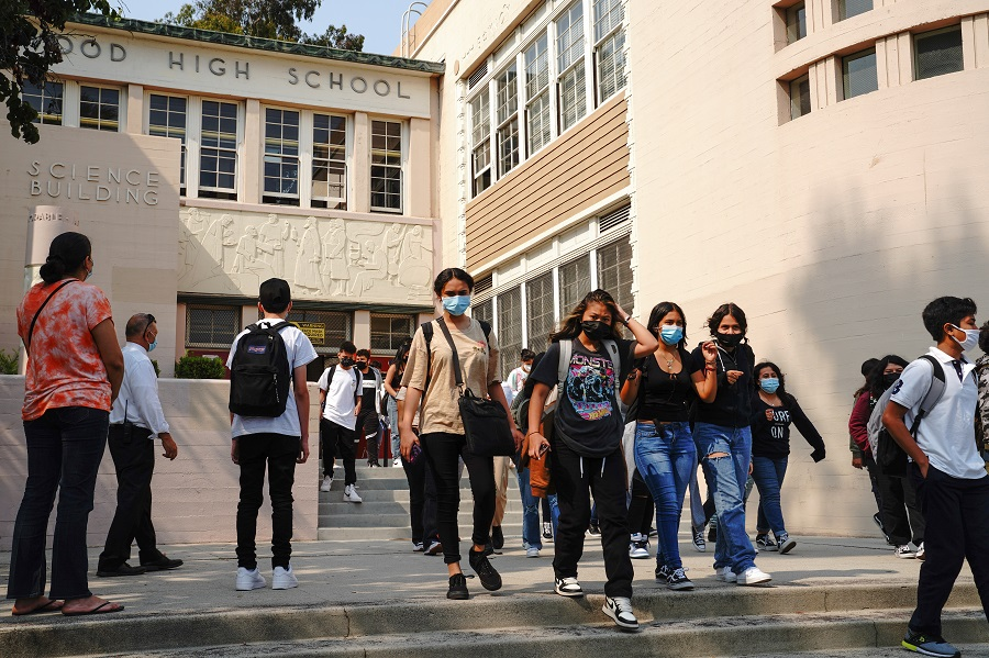 Students exit Hollywood High School after the first day of school in Los Angeles, California, US, on 16 August 2021. (Bing Guan/Bloomberg)