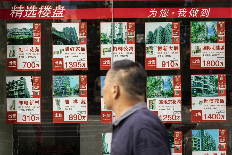 Listings of apartments for sale displayed at a real estate office in Shanghai, China, on 30 August 2021. (Qilai Shen/Bloomberg)