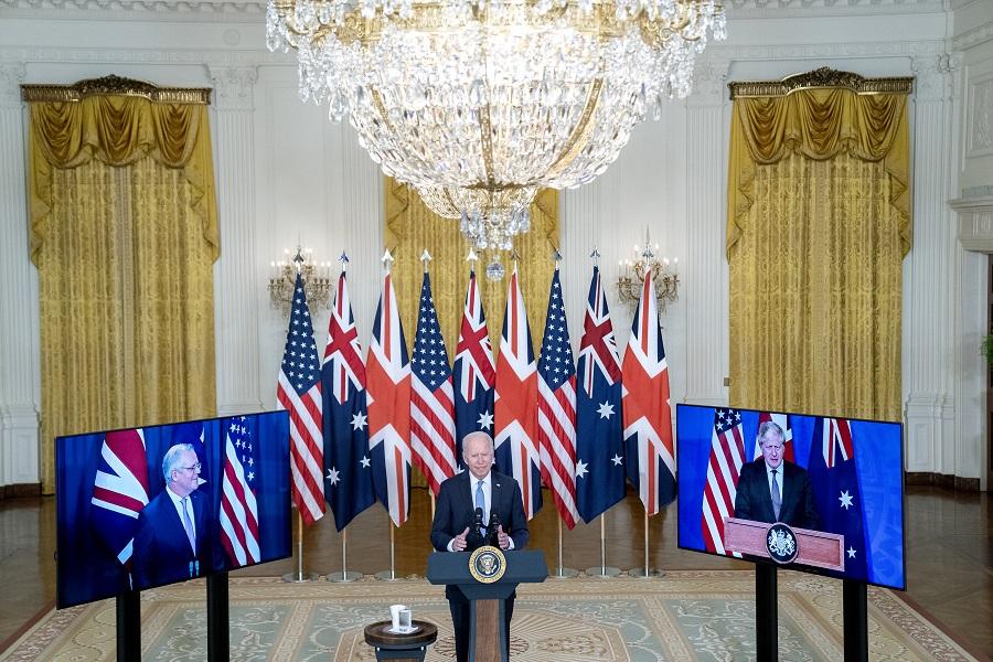 US President Joe Biden speaks in the East Room of the White House in Washington, DC, US, on 15 September 2021. Australian Prime Minister Scott Morrison appears on screen on the left, while UK Prime Minister Boris Johnson appears on screen on the right. (Stefani Reynolds/Bloomberg)