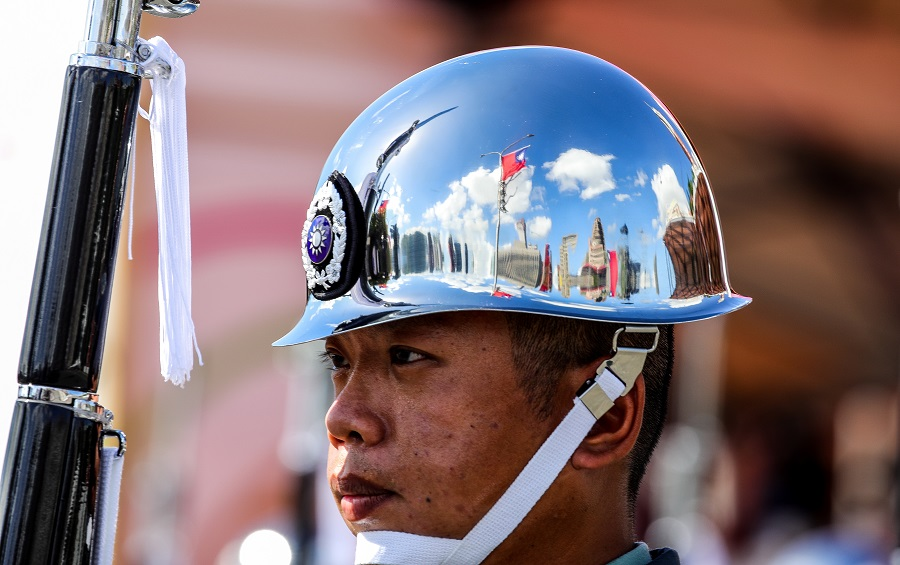 A Taiwanese flag is reflected on one of the Ministry of National Defense Honour Guards' helmet during the Double Tenth Day celebration in Taipei, Taiwan, on 10 October 2021. (I-Hwa Cheng/Bloomberg)