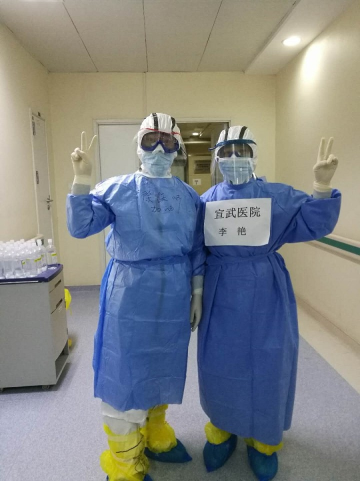 Dr Li Yan and her colleague in their personal protective equipment.