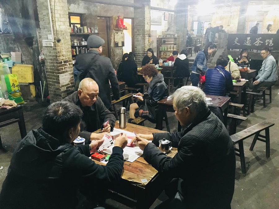 Customers enjoy tea and play cards at an old-fashioned teahouse in Chongqing, China, 23 December 2018. (SPH)