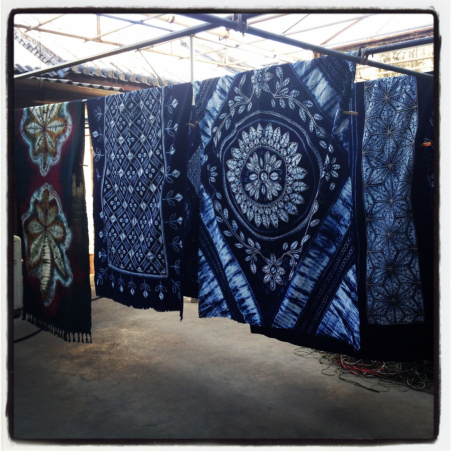 Tie dyed fabrics, of the  Bai ethnic minority, hang in the old village of Zhoucheng (周城村) at the foothills of Cangshan mountain in Yunnan.