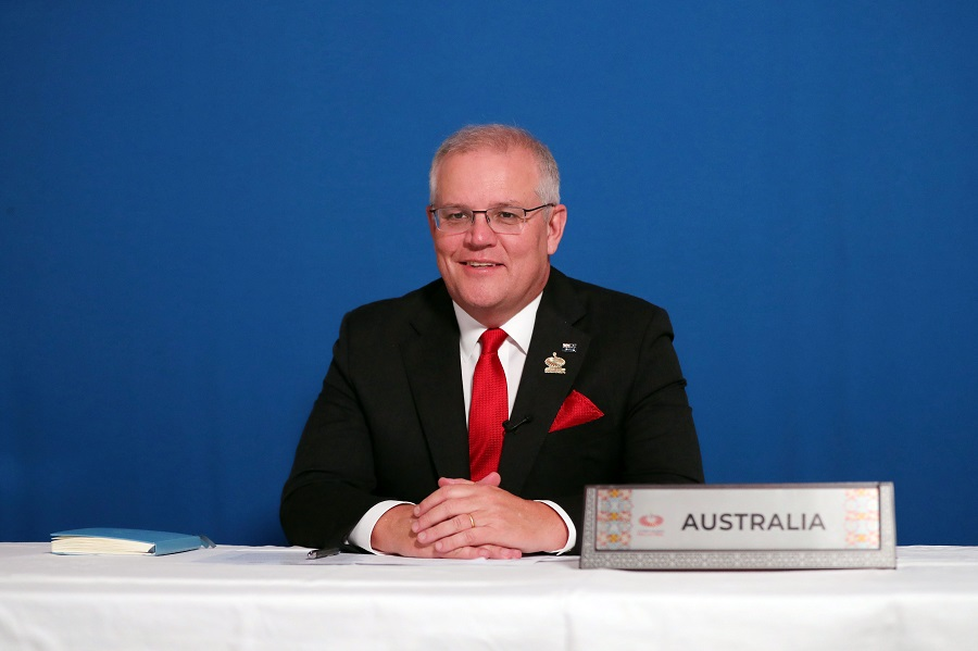 This handout picture taken on 21 November 2020 and released by the Australian Prime Minister's Office shows Australia's Prime Minister Scott Morrison attending an online session of the 2020 Malaysian APEC summit from Canberra along with other APEC leaders from around the world on 21 November 2020. (Adam Taylor/Prime Minister Office Australia/AFP)