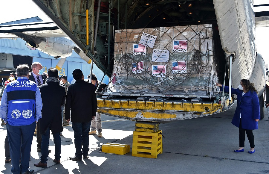 View of boxes containing some of 1,008,000 doses of US Johnson & Johnson vaccines against Covid-19 donated through the COVAX mechanism, upon their arrival at the Air Force base in El Alto, Bolivia, on 11 July 2021. (Aizar Raldes/AFP)