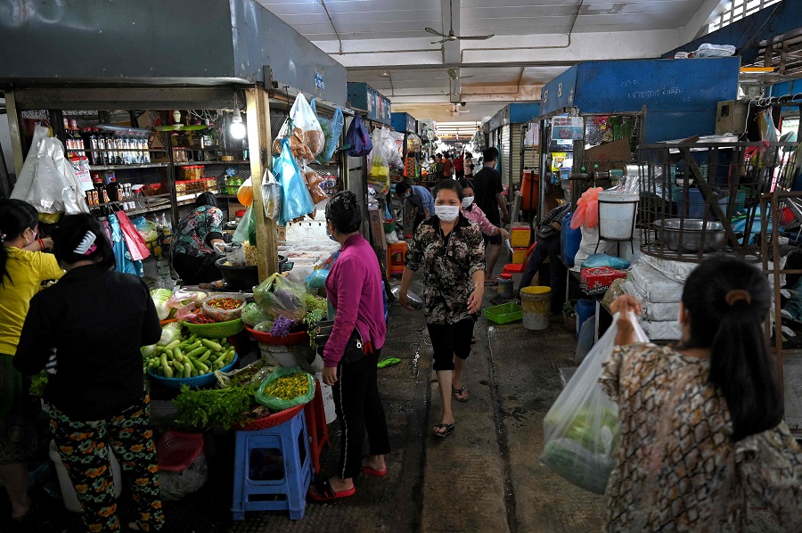 People walk through the Central Market in Phnom Penh, Cambodia, on 24 May 2021. (Tang Chhin Sothy/AFP)