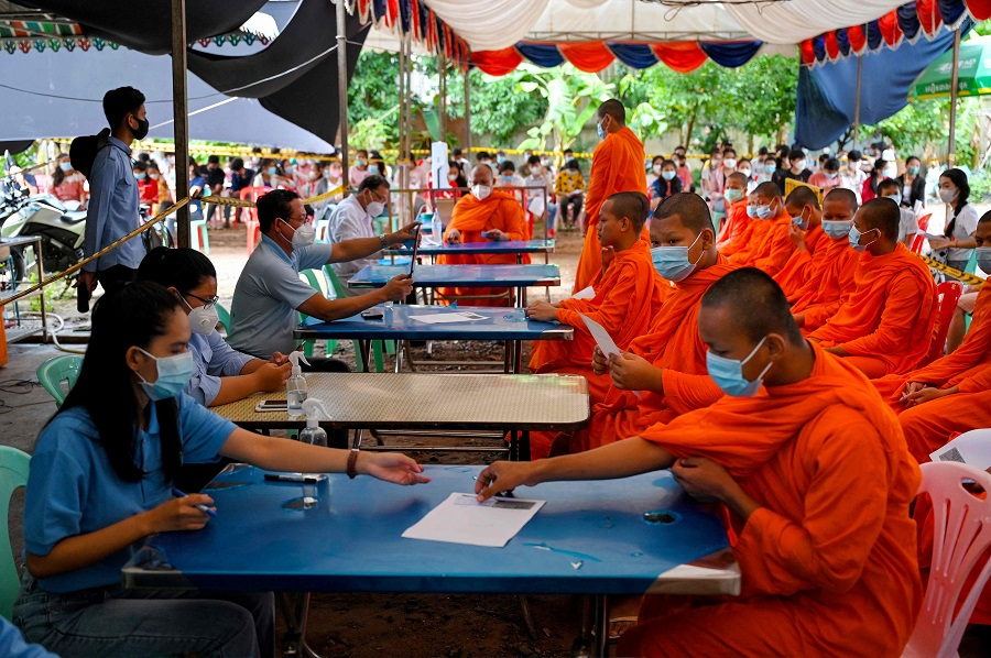 Buddhist monks register to receive the Sinovac Covid-19 coronavirus vaccine at a health centre in Phnom Penh, Cambodia, on 29 August 2021. (Tang Chhin Sothy/AFP)