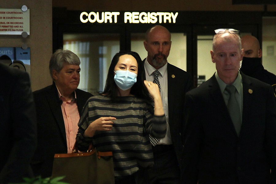 Huawei CFO Meng Wanzhou leaves the Supreme Court of British Columbia after appearing before a judge on 30 September 2020 in Vancouver, Canada. (David P. Ball/AFP)