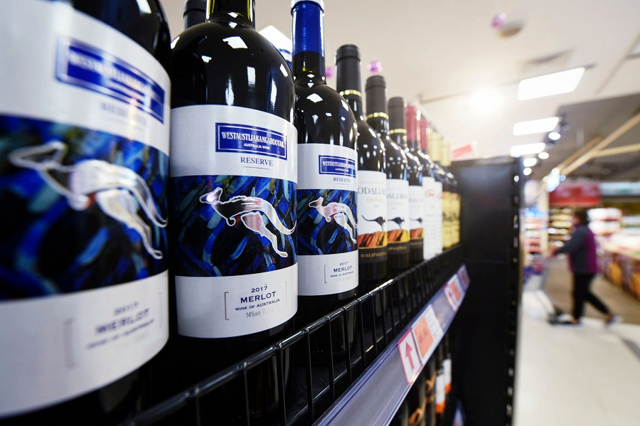 Bottles of Australian wine are displayed at a supermarket in Hangzhou, Zhejiang province, China, 27 November 2020. (STR/AFP)