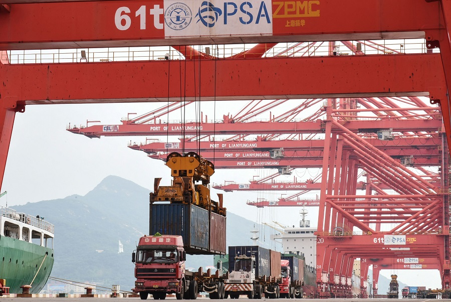 A crane loads a container onto a truck at Lianyungang Port in Lianyungang, Jiangsu province, China, 7 September 2021. (STR/AFP)