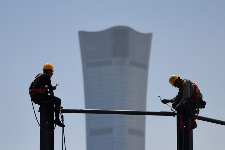 In this photo, the China Zun, the tallest building in Beijing, is seen in the background on 8 May 2021. (Greg Baker/AFP)