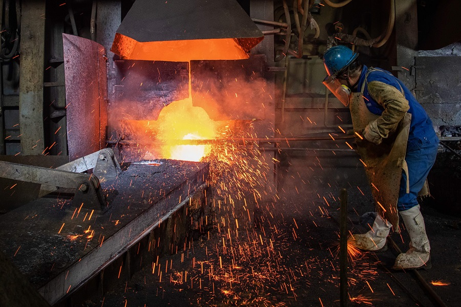 This photo taken on 1 April 2020 shows an employee working at a metal production plant in Huangshi, Hubei, China. (STR/AFP)