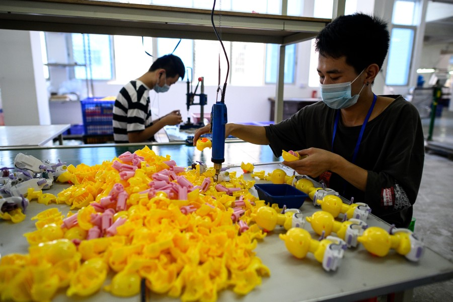 This photo taken on 20 May 2020 shows a worker assembling toys at the Mendiss toy factory in Shantou, Guangdong province, China. (Noel Celis/AFP)