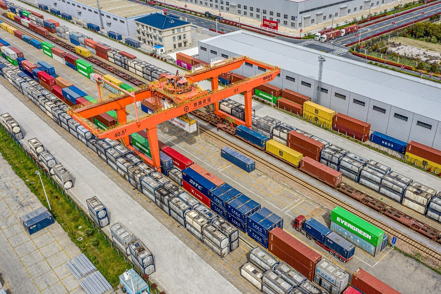 This aerial photo taken on 7 April 2021 shows a crane and containers at a logistic terminal in Nantong, Jiangsu province, China. (STR/AFP)