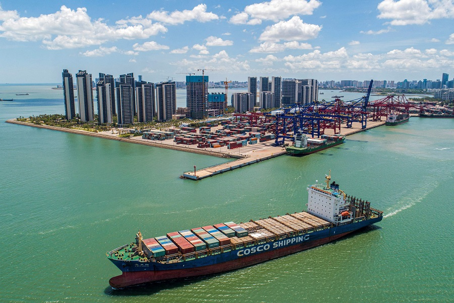 This aerial photo taken on 17 May 2021 shows a cargo ship loaded with containers leaving a port in Haikou, Hainan province, China. (STR/AFP)