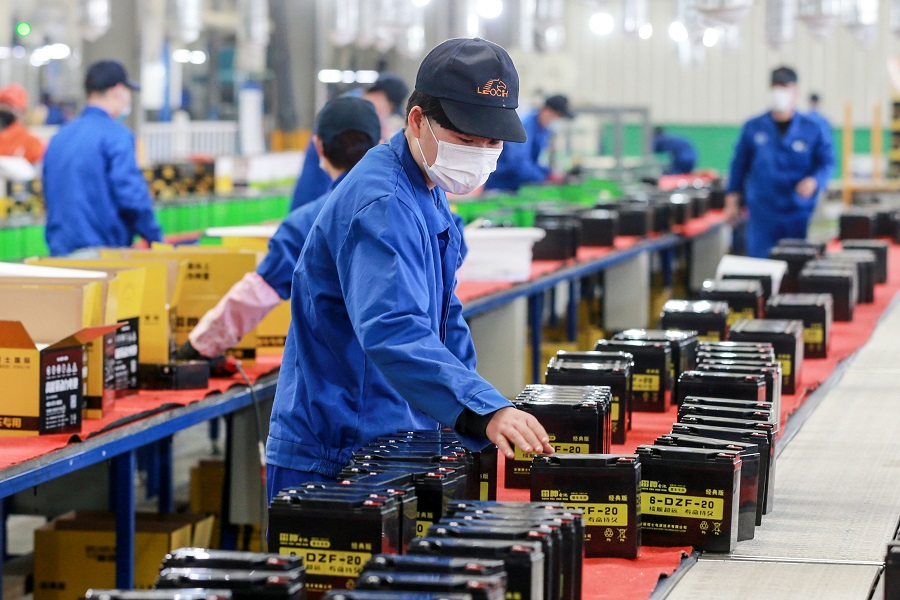 This photo taken on 30 March 2020 shows an employee working on a battery production line at a factory in Huaibei, Anhui, China, after work and production resumed. (STR/AFP)