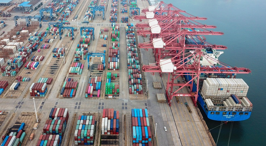 This aerial photo taken on 14 July 2020 shows containers stacked at a port in Lianyungang, Jiangsu, China. (STR/AFP)