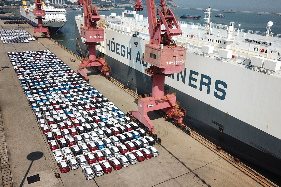 This aerial photo taken on 7 September 2020 shows cars waiting to be exported at a port in Lianyungang, Jiangsu, China. (STR/AFP)