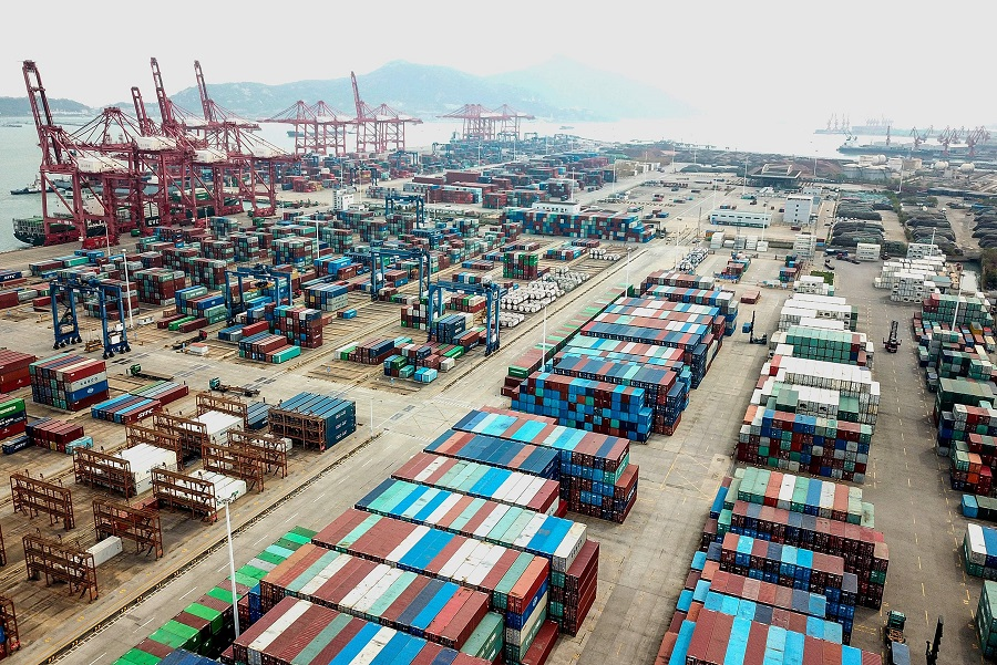 This aerial photo taken on 14 April 2020 shows containers stacked at a port in Lianyungang, Jiangsu, China amid a decline in foreign trade due to the Covid-19 pandemic. (STR/AFP)