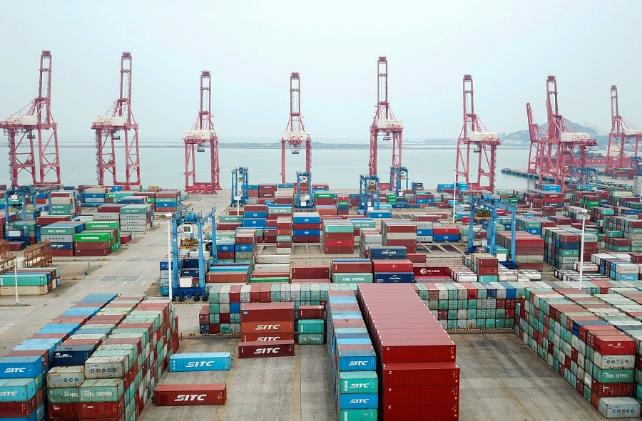 An aerial view shows the container port in Lianyungang, Jiangsu province, China, on 13 October 2020. (STR/AFP)