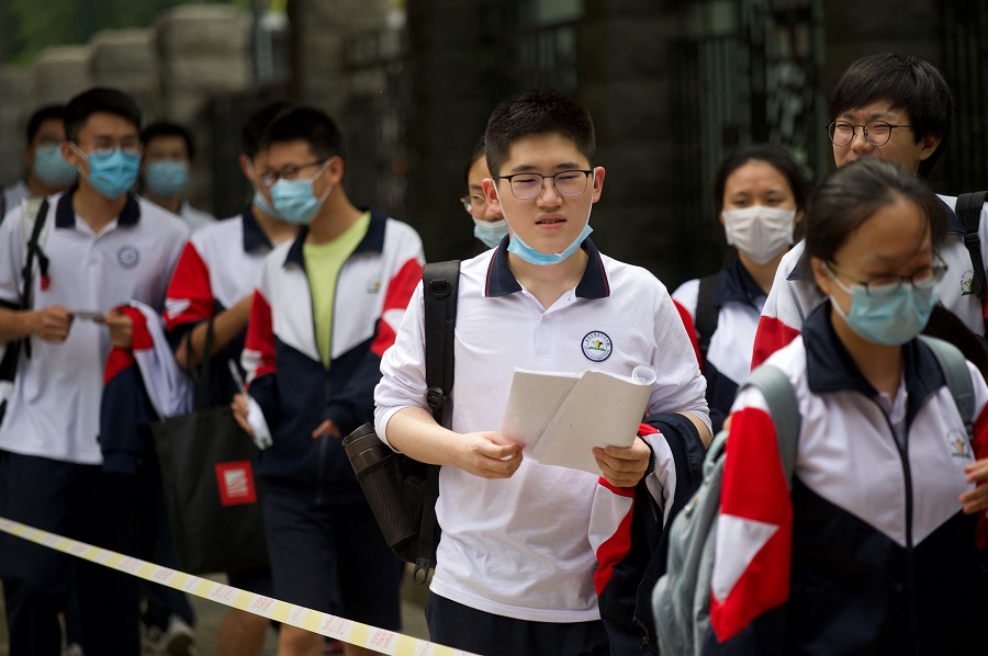 Students enter a school to sit for the first day of gaokao (National College Entrance Examination) in Beijing, China on 7 July 2021. (Wang Zhao/AFP)