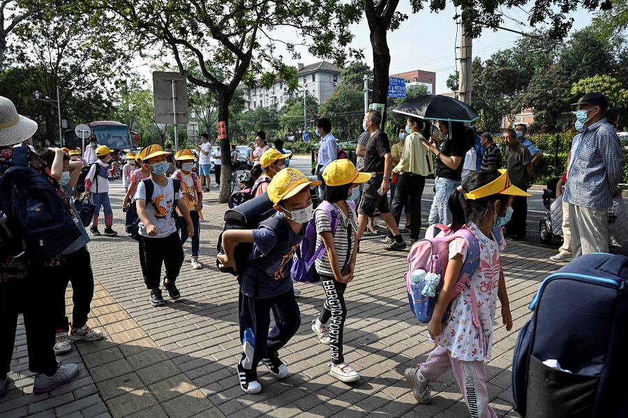 Children leave school following the end of the day's lesson in Beijing, China, on 10 September 2021. (Jade Gao/AFP)