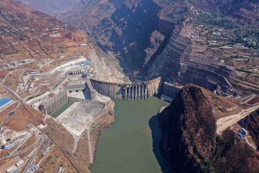 This aerial photo taken on 22 April 2021 shows the construction site of the Baihetan hydropower station in Zhaotong, Yunnan province, China. (STR/AFP)