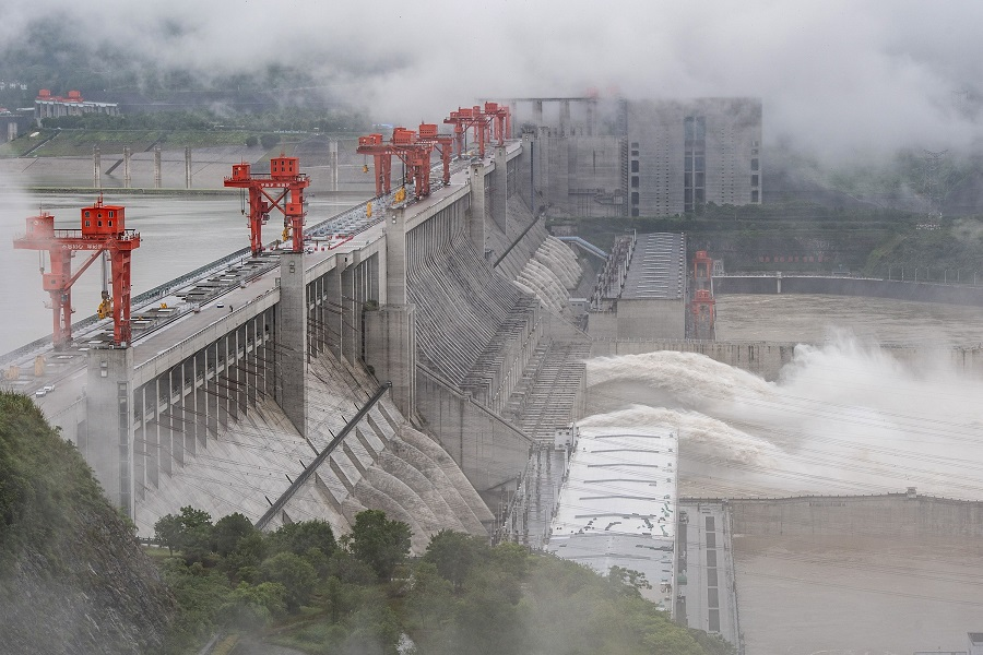This picture taken on 29 June 2020 shows water being released from the Three Gorges Dam, a gigantic hydropower project on the Yangtze river, in Yichang, China. (STR/AFP)
