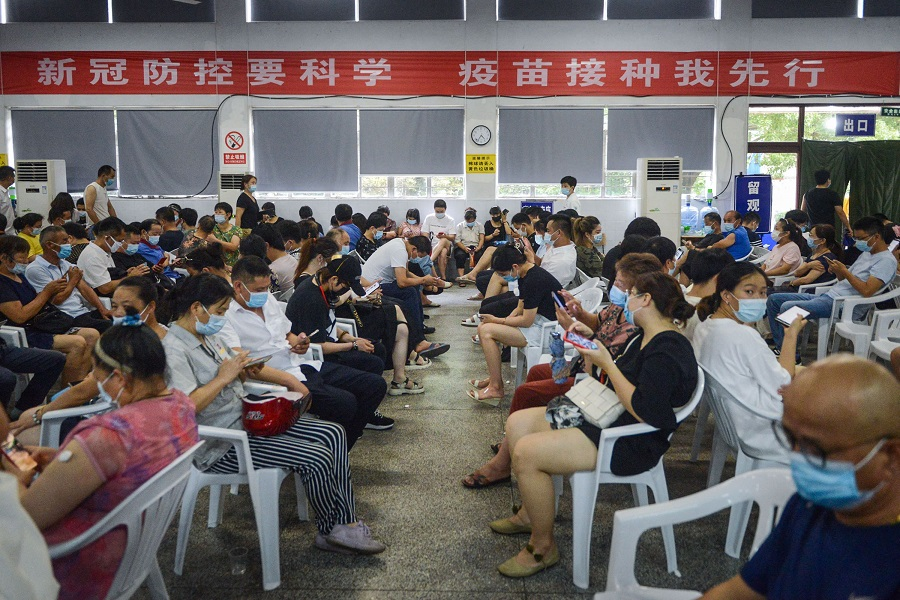 This photo taken on 10 August 2021 shows people in observation after receiving the Covid-19 vaccine in Ningbo, Zhejiang province, China. (STR/AFP)