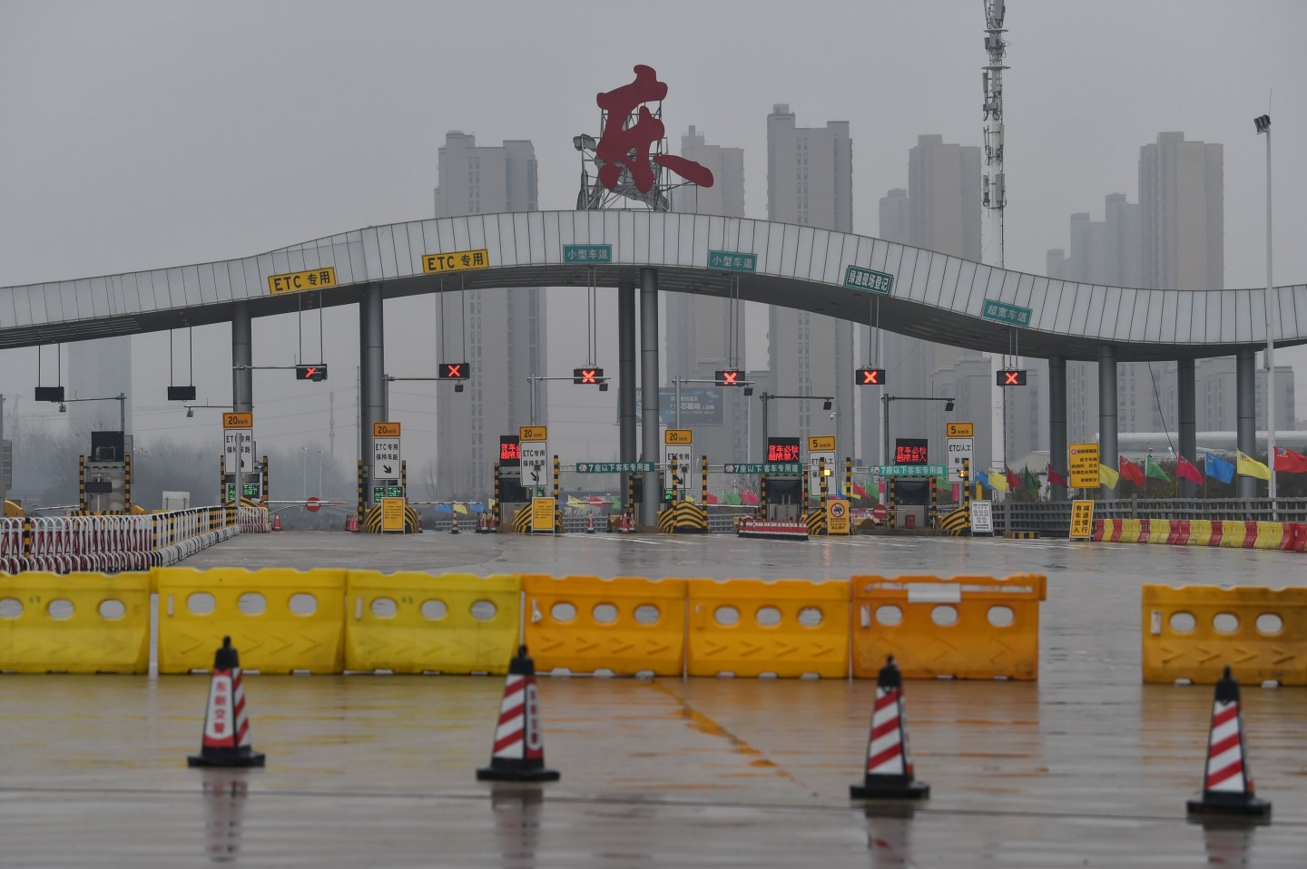 A general view shows one of the roads blocked by the police to restrict people from leaving Wuhan city. Millions spent their normally festive Lunar New Year holiday under lockdown. (Hector Retamal/AFP)
