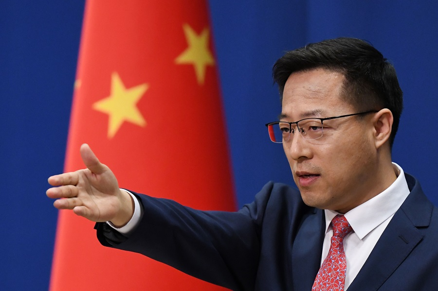 Chinese foreign ministry spokesperson Zhao Lijian takes a question at the daily media briefing in Beijing on 8 April 2020. (Greg Baker/AFP)