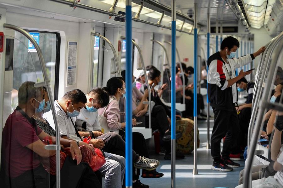 Passengers ride the subway in Wuhan, Hubei, China, on 28 September 2020. (Hector Retamal/AFP)
