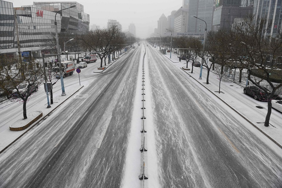 An empty Beijing street is seen on 5 February 2020, as China continues its fight against the coronavirus outbreak. (Greg Baker/AFP)