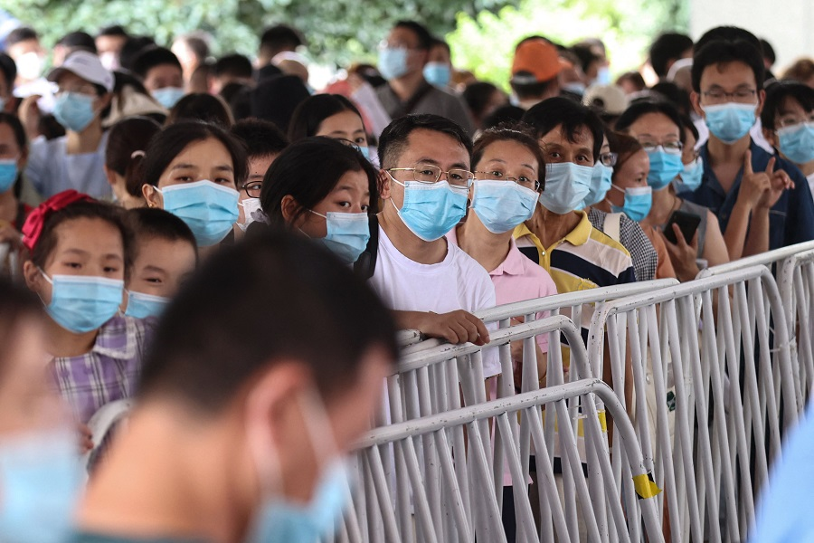 Residents queue to receive nucleic acid tests for the Covid-19 coronavirus in Nanjing, Jiangsu province, China, on 21 July 2021. (STR/AFP)