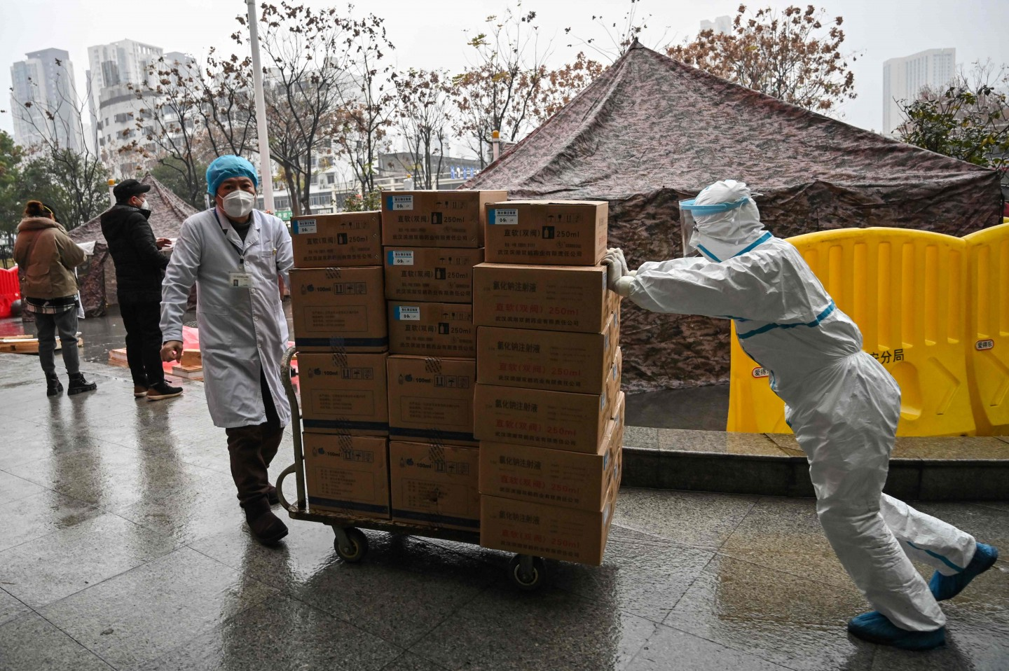 Medical staff transport supplies at the Wuhan Red Cross Hospital in Wuhan on 24 January 2020. (Hector Retamal/AFP)