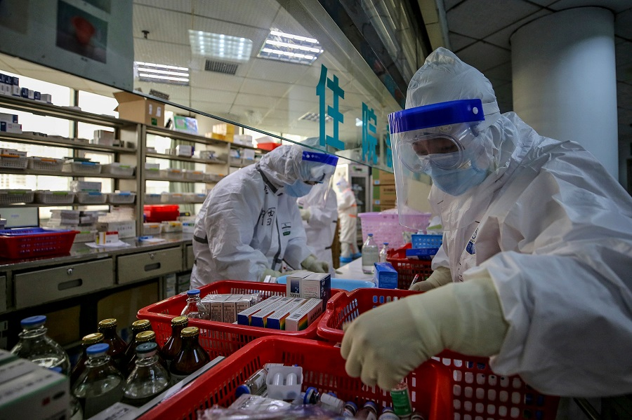 As of now, over 90% of America's antibiotics, vitamin C and ibuprofen are produced in China. In this photo taken on 10 March 2020, medical staff are seen arranging medicine at Red Cross Hospital in Wuhan. (STR/AFP)