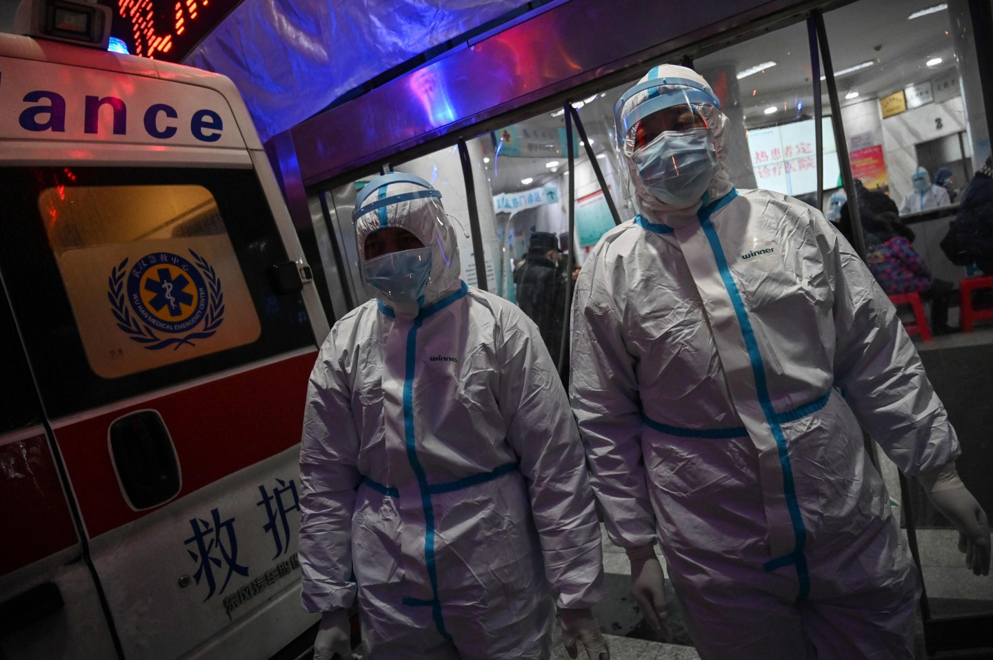 Protective clothing like the ones medical staff members are seen wearing in this photo taken on 25 January 2020 at the Wuhan Red Cross Hospital remain scarce. (Hector Retamal/AFP)