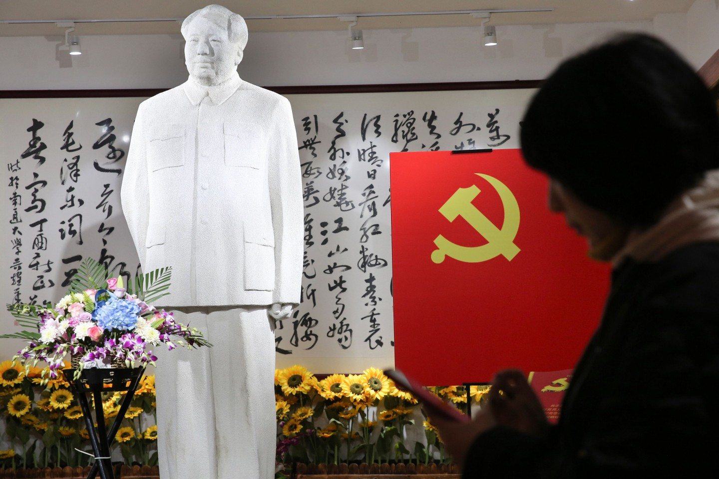 China is shaped by the secular religion of communism. In this photo taaken on 26 December 2019, people visit a museum of artworks of the late former Chinese Communist Party leader Mao Zedong to mark his 126th birthday, in Nantong, Jiangsu. (STR/AFP)