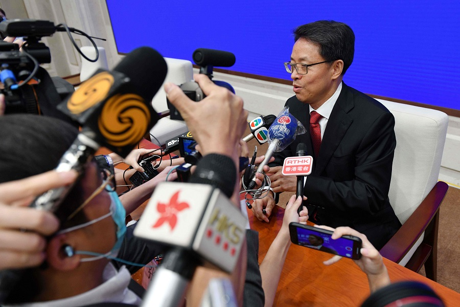 Zhang Xiaoming, executive deputy director of the Hong Kong and Macao Affairs office of the State Council, speaks to journalists at the end of a press conference about the new Hong Kong national security law in Beijing on 1 July 2020. (Greg Baker/AFP)